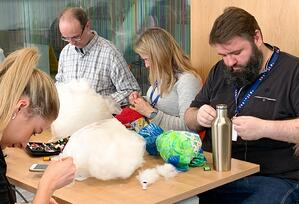 Congenica team stitching their RARE Bears for Rare Disease Day